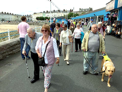 group walking through llandudno